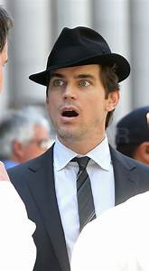 Matthew Bomer topped off his look with a coordinating hat ...