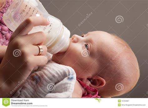 Baby Girl Drinking Milk Royalty Free Stock Photography