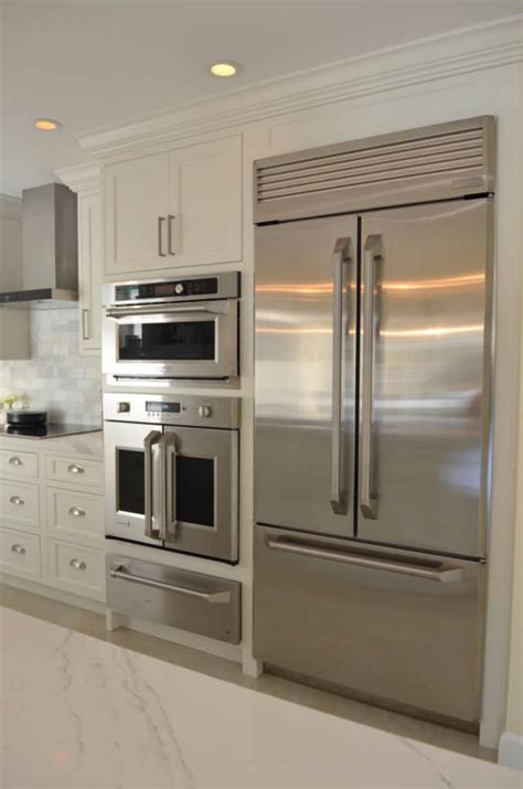 refrigerator wall featuring subzero waterview kitchens