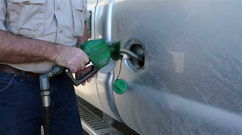 Man Filling Truck Gas Tank Diesel Fuel. Person On Filling