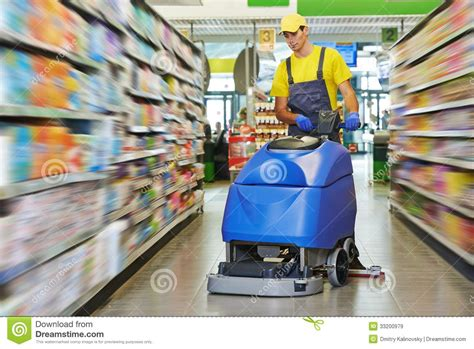 Harga The Shop Clean Free worker cleaning store floor with machine royalty free