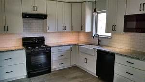 poll white cabinets black appliances granite and orb cabinet pulls 1511