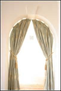 hanging curtains on arched window arch window curtains to