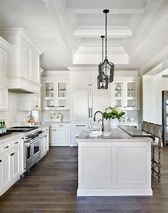 White Raised Panel Kitchen Cabinets with White Mini Subway