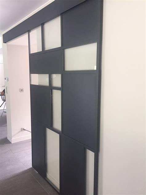 Porte coulissante en verre et métal  Atelier du verre