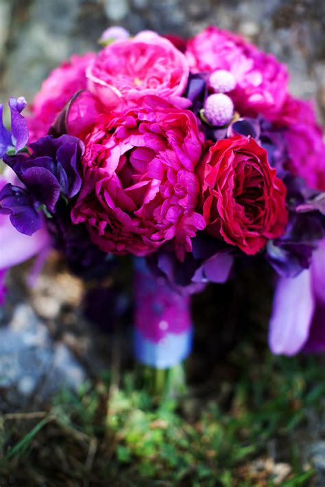 pink or purple flowers elegant malibu wedding with bold wedding flowers purple pink bouquet onewed com