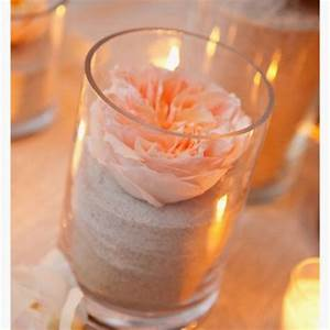 Easy beach centerpiece, sand, flower and candles. For more ...