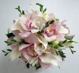 orchid boutonniere cymbidium call and freesia bouquet dahlia floral design