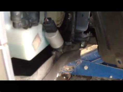 bmw windshield washer fluid pump replacement diy part