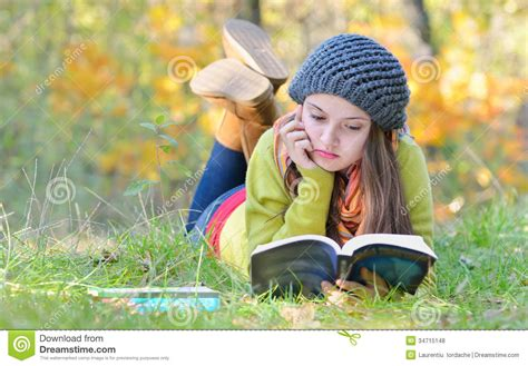 Beautiful Girl Reading A Book Outdoor Stock Photo  Image Of Lady, Face 34715148