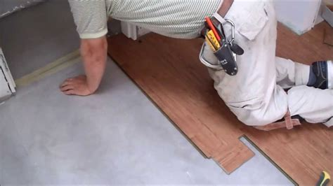installing laminate flooring on concrete how to install laminate flooring on concrete slab in tiny room mryoucandoityourself youtube