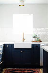 brushed bronze kitchen faucet navy shaker kitchen cabinets with brushed brass knobs transitional kitchen sherwin
