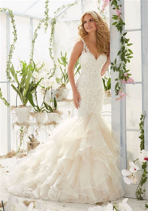 pearls and crystals on lace mermaid wedding dress style