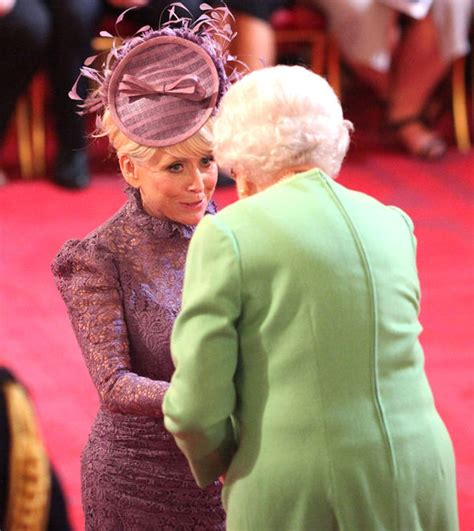 Barbara Windsor beams as she receives damehood from ...