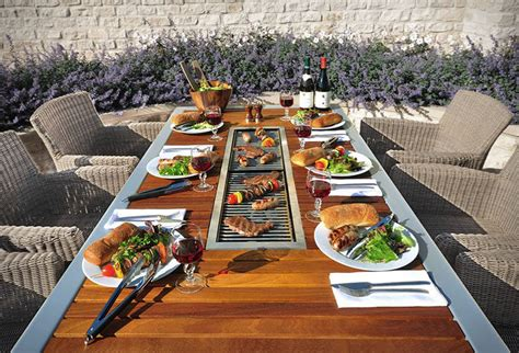 this outdoor table has a built in bbq grill contemporist