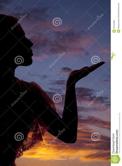 silhouette woman blow kiss  close royalty  stock
