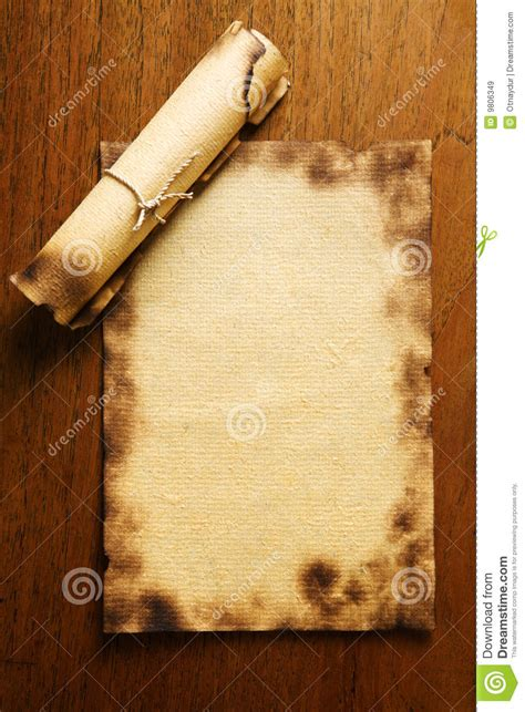 blank paper  scroll  wooden table royalty
