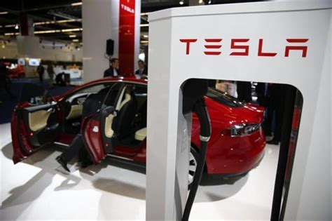 tesla hires apple s former chief mac engineer to vehicle development technology news