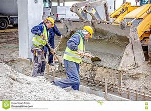 Workers Are Unloading Concrete With Shovel From Excavator ...