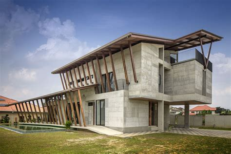 Check out this bold concrete house with an outdoor terrace