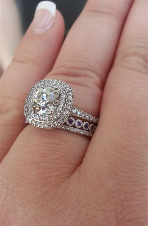 round center stone with cushion halo engagement rings