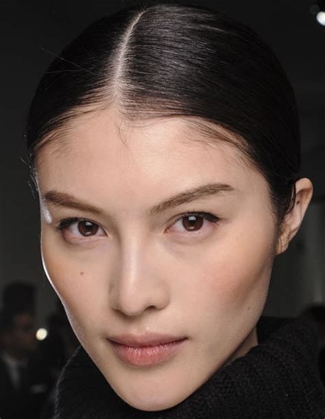 sui hes middle part sleek bun prom wedding casual