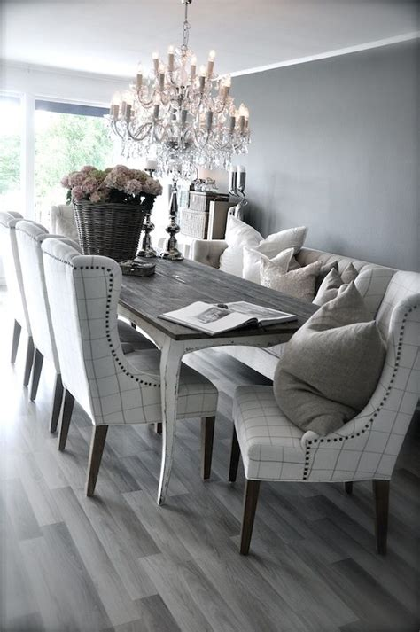 grey rustic dining table with beautiful fabric chairs the