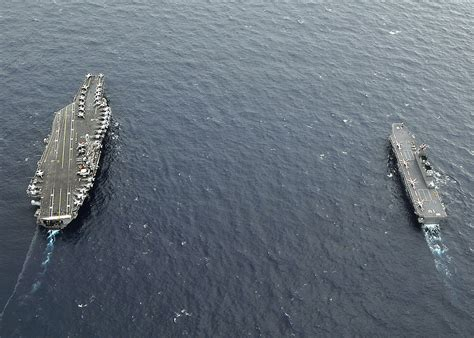 japan celebrates hiroshima day launches carrier weaponsman