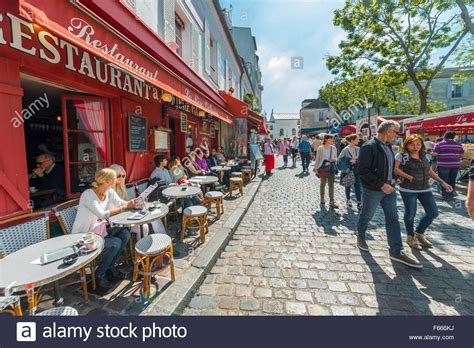 Restaurants And People On Street In Montmartre Paris Ile