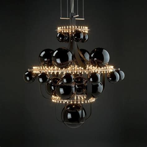 unique chandelier reminding of the solar system digsdigs