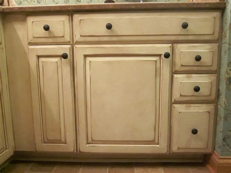 Tiny Distressed White Kitchen Cabinets With Round Black