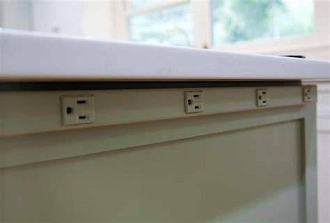 Outlet strip for under the raised bar counter in lieu of