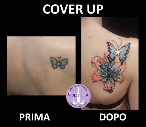 tatuaggio farfalla con fiore tatuaggio fiore giglio a colori arancione azzurro verde