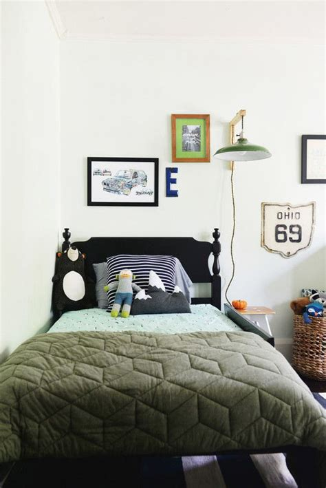 boys bedroom idea prints  wall light   bed
