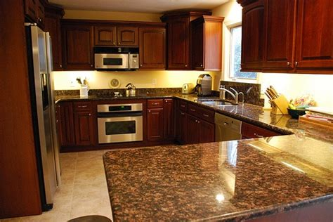 yellow and brown kitchen ideas yellow walls cherry cupboards brown counter floor