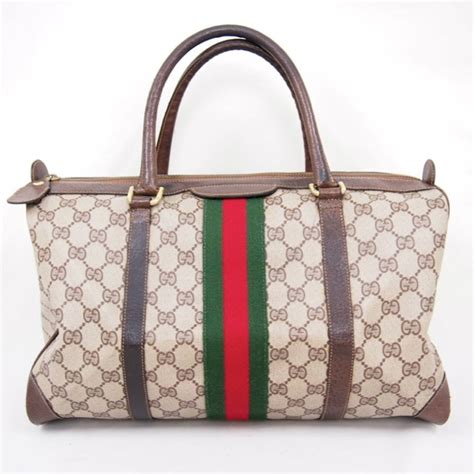 vintage gucci monogram canvas ribbon speedy bag medium