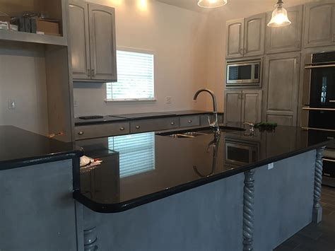 pictures of kitchen islands black pearl midnight granite countertops in kitchen bath 4214