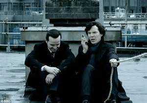 sherlock face moriarty building rooftop thrown himself while watson dummy sits behind character phone