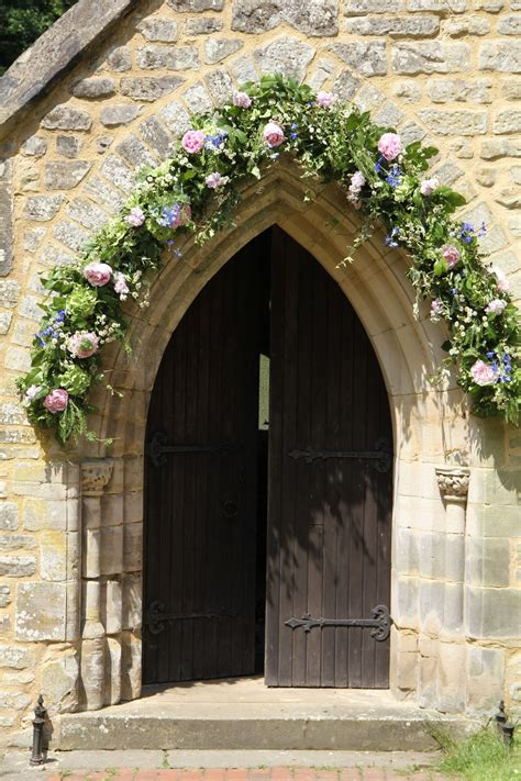 Church Doors Adorned With Flowers Church Wedding Flowers