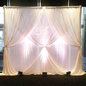 multi layered chiffon wedding backdrop with 2 layer curtain ties lighting for hire please