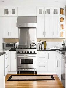 Black countertops and white cabinets transitional for Kitchen designs with white cabinets and black countertops