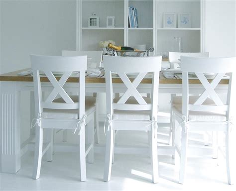 white wooden kitchen table and chairs