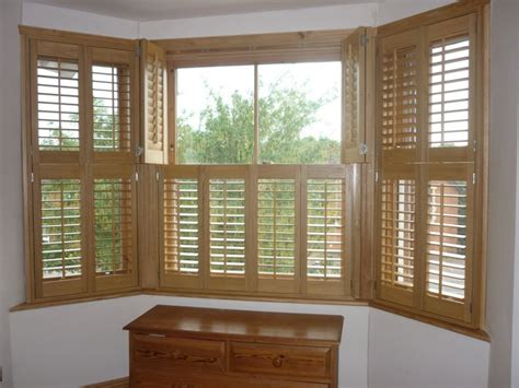 shutters  windows  grasscloth wallpaper