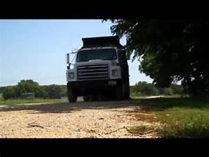 Dump Truck dumping gravel - YouTube