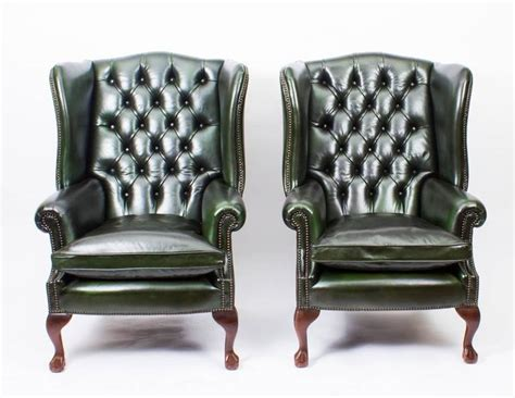 pair of leather chippendale wingback armchairs emerald