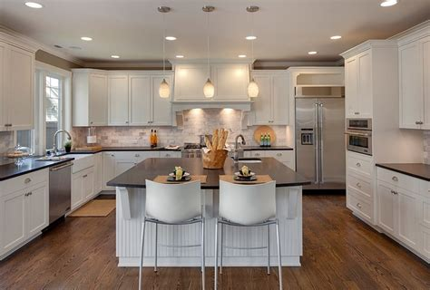 l shaped kitchen islands with seating island vs peninsula which kitchen layout serves you best
