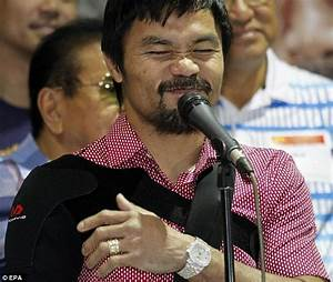 Manny Pacquiao returns to Manila with arm in a sling after ...