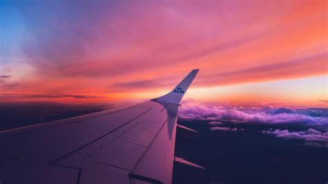 fonds decran aile davion coucher de soleil nuages