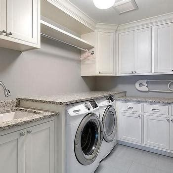 are granite countertops safe large cottage laundry room with two gray barn doors on
