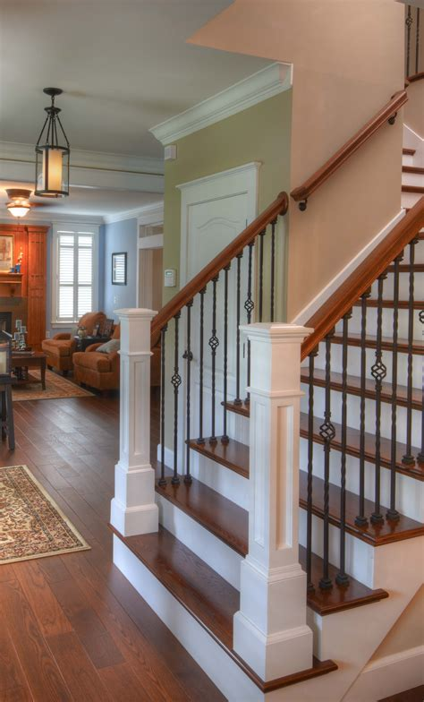 wood banisters hardwood flooring up the stairs classic look rod iron